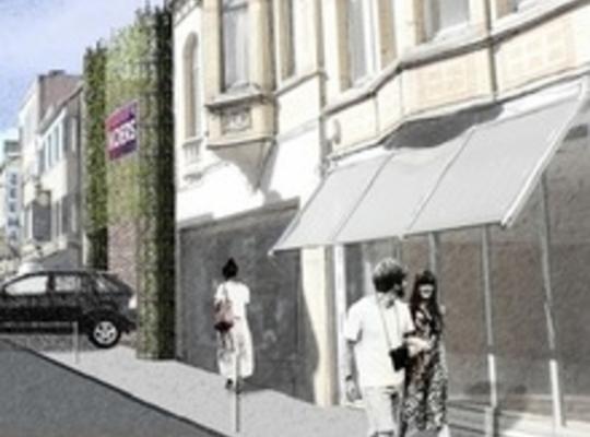 Een beeld van hoe de vernieuwde Marktstraat er kan uitzien, compleet met groene gevel aan de parkeerhaven. © GF